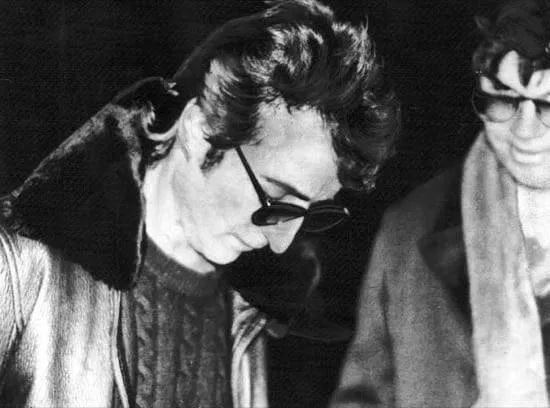 John Lennon y Mark David Chapman.